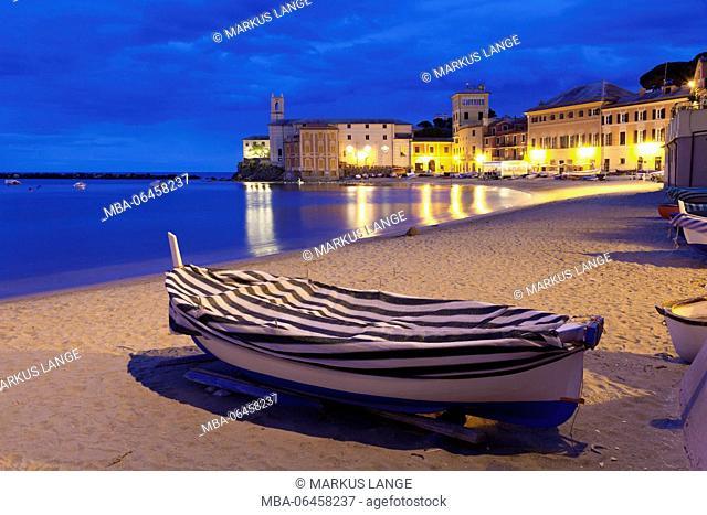Fishing boat on the town beach in the bay Baia del Silenzio with church Chiesa di San Nicolo, Sestri the Levant, province Genoa, Rivera di Levante, Liguria