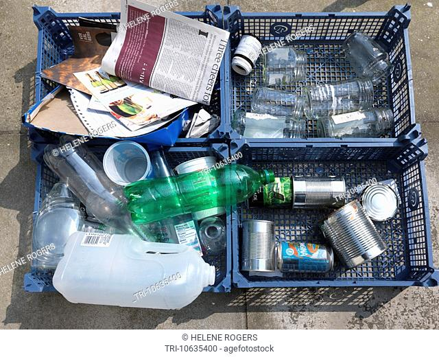 Domestic Recycling Divided Into Grouping Tins, Plastics, Glass And Paper