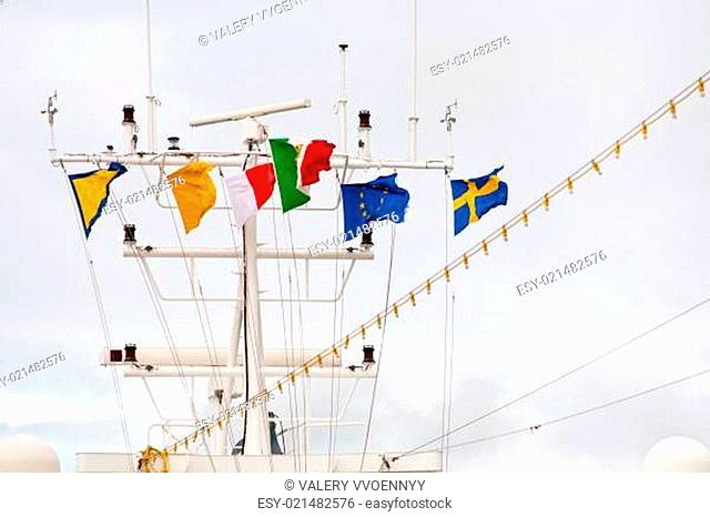 pennants on navigation antenna of cruise liner