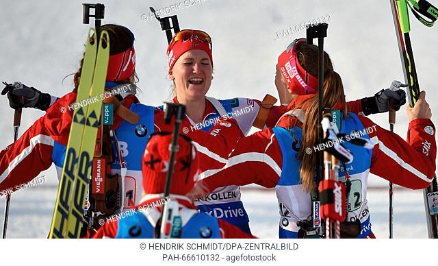 Gold medalists (L-R) Synnoeve Solemdal, Tiril Eckhoff, Marte Olsbu, and Fanny Horn Birkeland of Norway react in the finish area during the Women 4x6 km Relay...