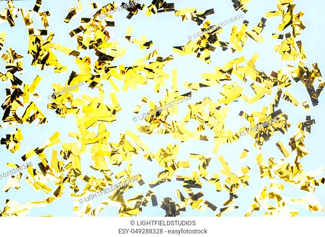 top view of golden glossy confetti isolated on white