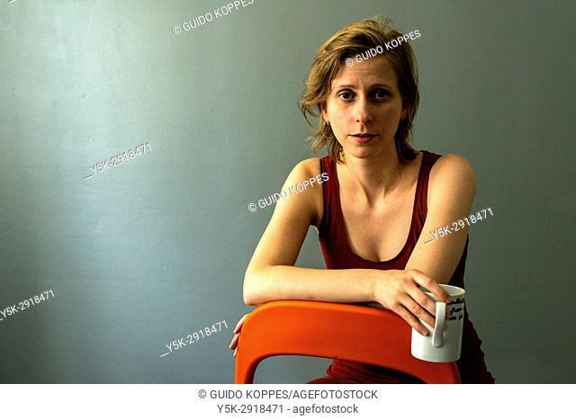 Tilburg, Netherlands. Studio portrait of an adult, androgyn woman