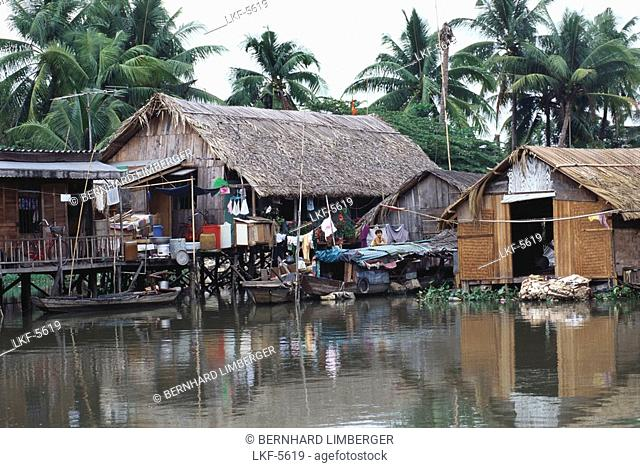 Stilted houses in the river, Saigon, Vietnam, Asia