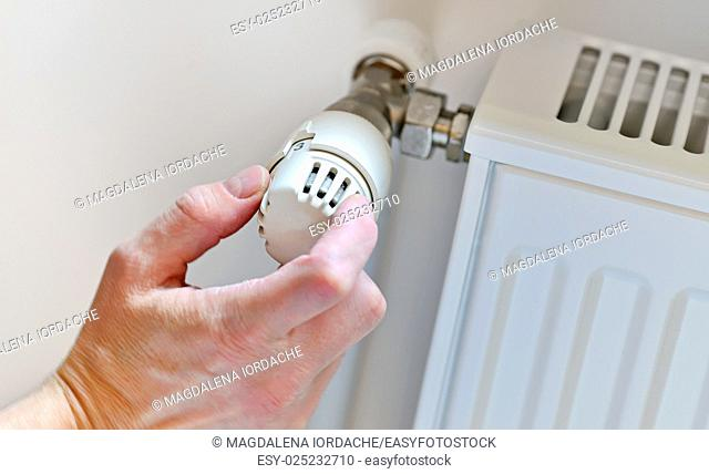 Hand Adjusting Heater Thermostat in winter time