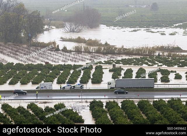 Alberic, Valencia, Spain, January 21, 2020. Police and Guardia Civil controlling the traffic of vehicles on the A7 flooded by the overflow of the river Jucar...