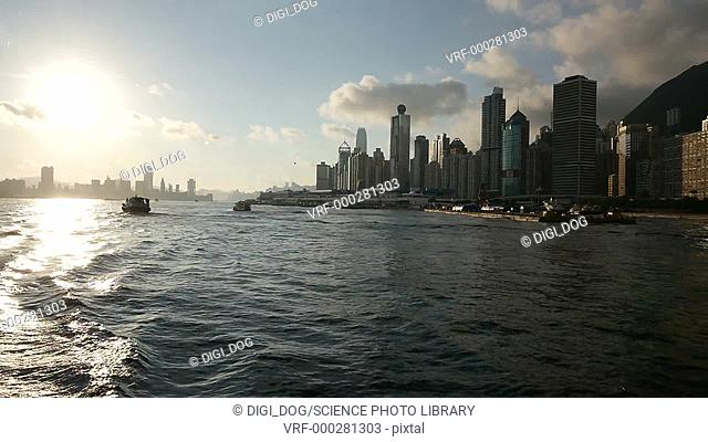 The city of Hong Kong as filmed from a boat traveling along the waterfront, China