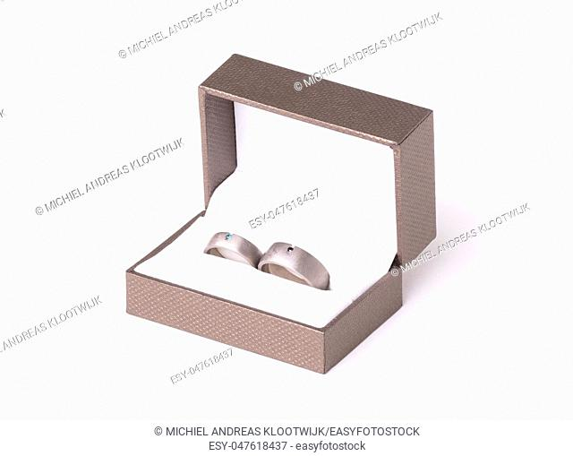 Wedding rings in box, isolated on white background