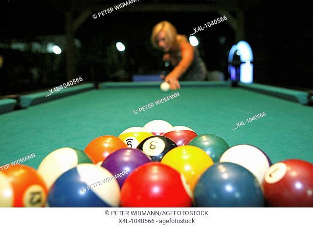 Woman Playing Billiard