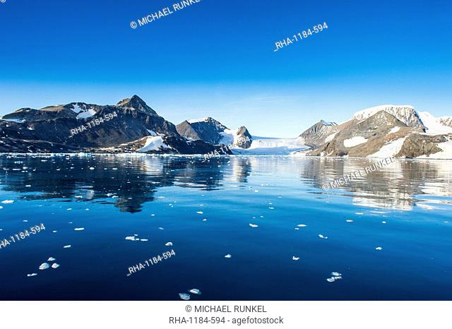 Mountains reflecting in glassy water of Hope Bay, Antarctica, Polar Regions