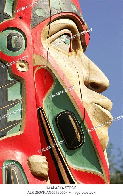 Close up of a face on a traditional Haida totem carving in Ketchikan, Alaska