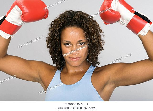 African woman wearing boxing gloves