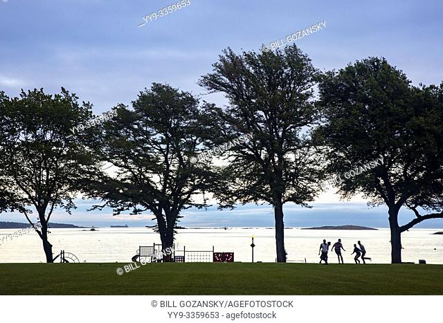 Kids playing football in Willows Park in Oak Bay- Victoria, Vancouver Island, British Columbia, Canada