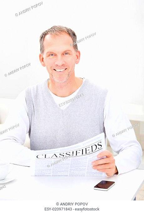 Mature Man Reading Newspaper