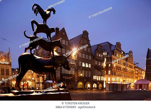 Bremen Town Musicians with snow at dusk, Bremen, Germany, Europe
