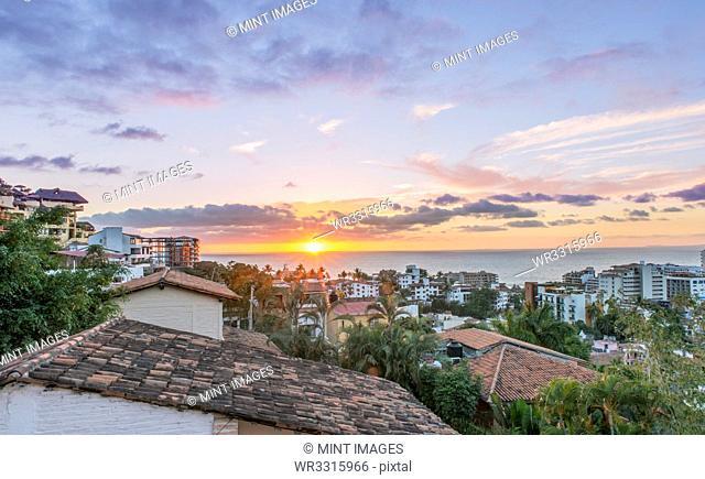 Aerial view of city rooftops, sunrise and horizon, Puerto Vallarta, Jalisco, Mexico