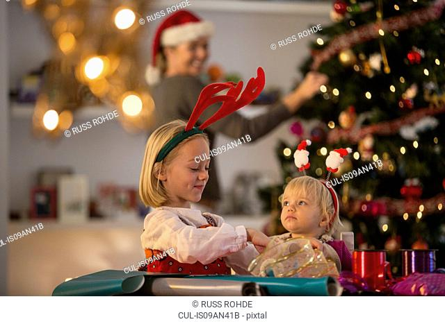 Mother and daughters preparing for Christmas