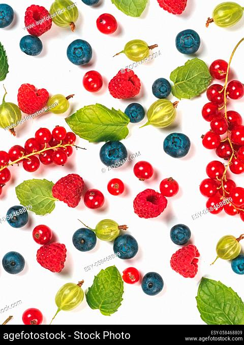 Various fresh summer berries background. Pattern of fresh blueberries, red currant, raspberries, gooseberries isolated on white background