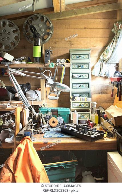 Various tools on workbench at garage
