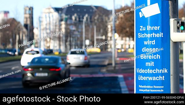 """21 January 2020, Lower Saxony, Hanover: A sticker """"""""For your safety this area is monitored by video technology"""""""" of the Hanover police sticks to a traffic light..."""