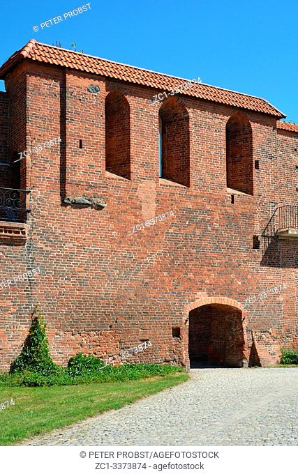 Old city wall of Torun with a defence tower from the 13th century - Poland