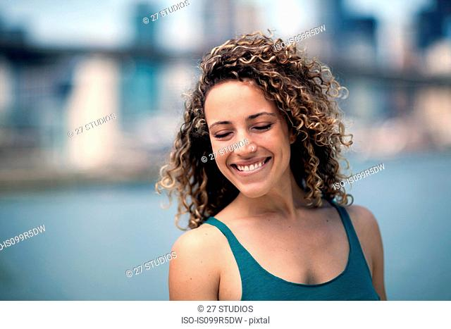 Portrait of woman with curly hair, smiling