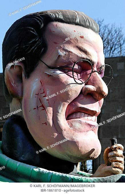Huge head of the resigned political star Karl-Theodor zu Guttenberg, paper-mache figure, satirical themed parade float at the Rosenmontagszug Carnival Parade...