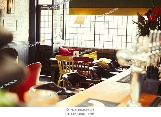 Bar and table with cushions in empty bar