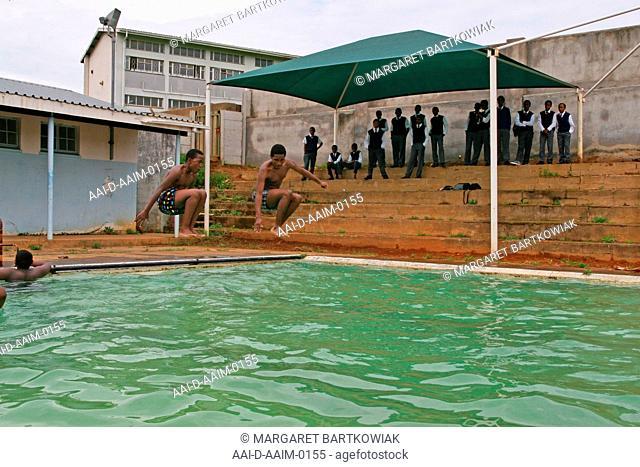 School boys jumping into swimming pool, St Mark's School, Mbabane, Hhohho, Kingdom of Swaziland