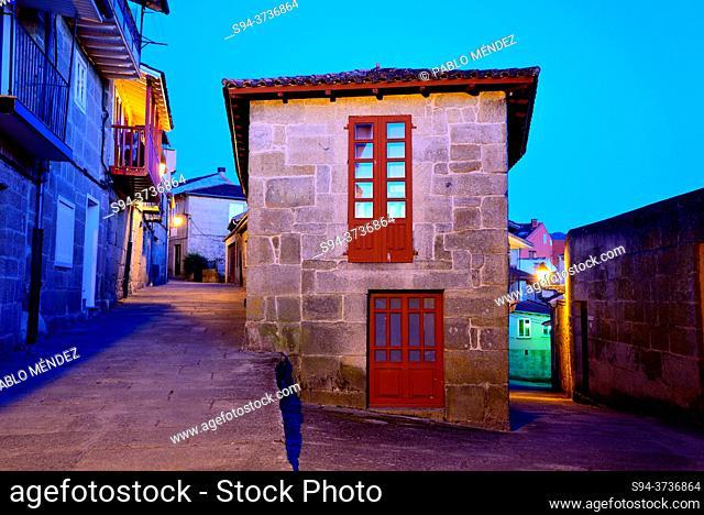 Building between streets in Allariz, Orense, Spain