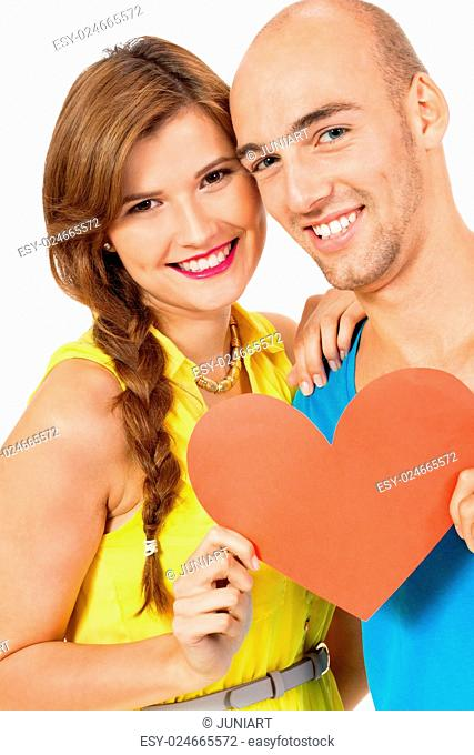 happy young couple in love with red heart valentines day isolated portrait