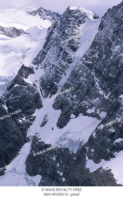 Alpine lake with glacier and mountains surrounding, Lake of the Hanging Glacier, East Kootenays, B C