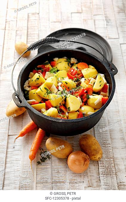 Vegetable and potato stew in a pot