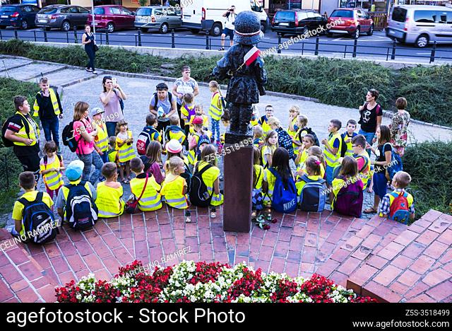 Polish schoolchildren visit the statue of the Maly Powstaniec, the Little Insurrectionist, statue in commemoration of the child soldiers who fought and died...