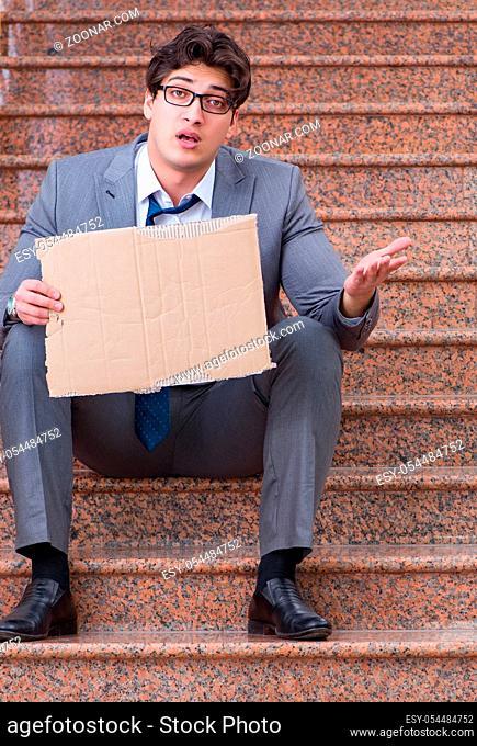 Desperate businessman begging on the street
