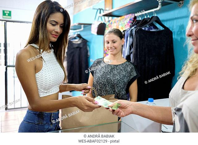 Customer paying for purchase in fashion boutique