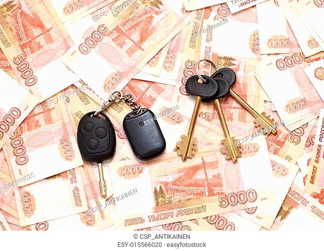 House keys and car key on cash