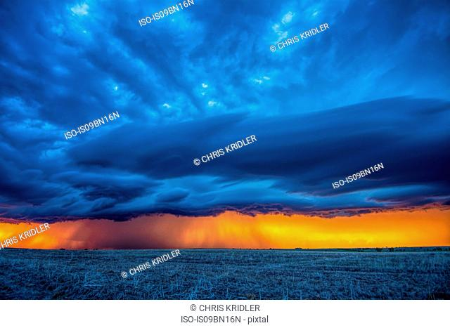 Incredible colors glow after sunset in line of storms, Studley, Kansas
