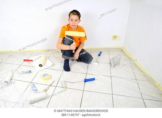 Paintwork, boy with rollers and other painting utensils