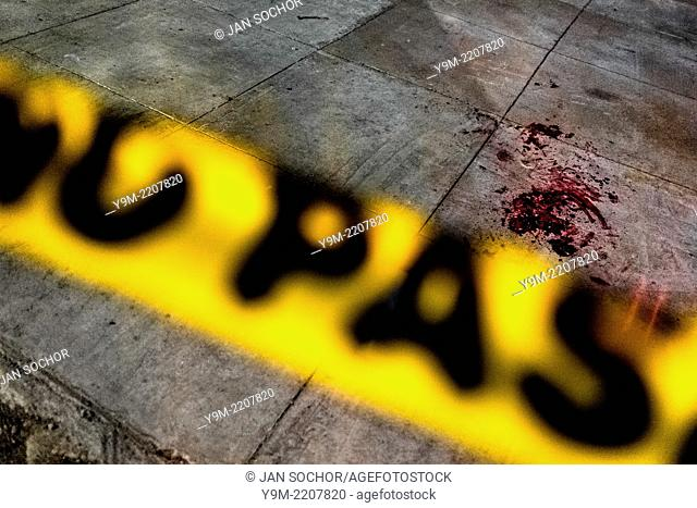 A pool of blood seen on the floor after a shooting incident between gang members and police on the street in a gang neighbourhood of San Salvador, El Salvador