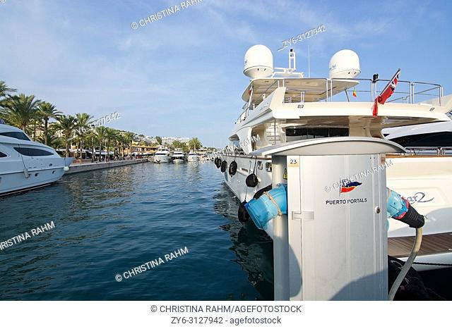 MALLORCA, SPAIN - AUGUST 30, 2018: Luxury yachts and power outlet in Puerto Portals marina on a late summer sunny afternoon on August 30, 2018 in Mallorca