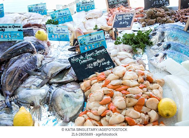 specialty seafood, fish, bake goods and vegetables and fruits on display at the local market in Brittany, france