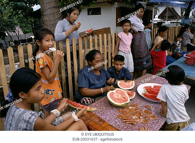 Family group eating watermelon