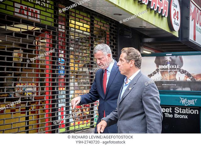 New York Mayor Bill de Blasio, left, and New York State Governor Andrew Cuomo visit the site of the previous night's bombing in the Chelsea neighborhood of New...