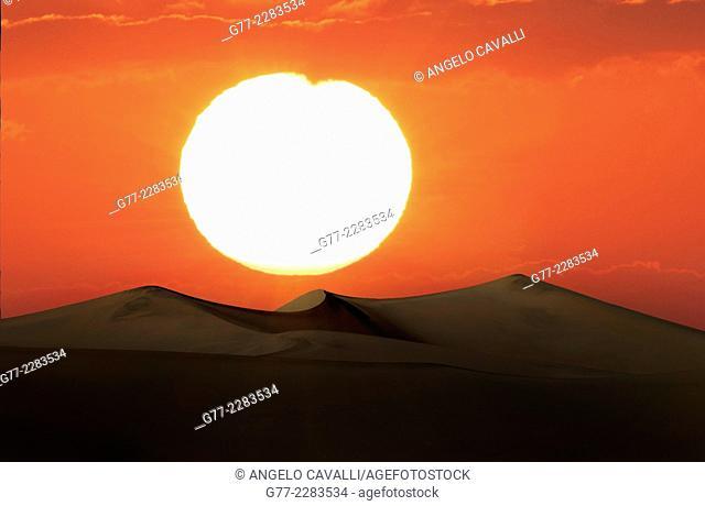 Sunset over sand dunes in Namib desert, Sossusvlei, Namibia