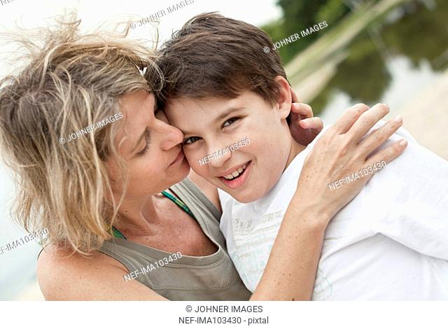 Mother with son on beach
