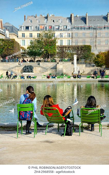 Paris, France. Jardin des Tuileries. Autumn - people relaxing around the Bassin Octagonal (pond)