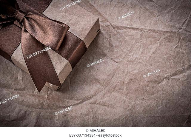 Gift box on wrapping paper holidays concept