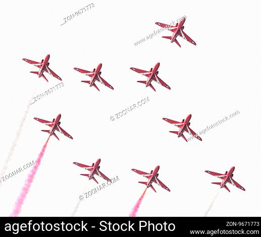 LEEUWARDEN, THE NETHERLANDS - JUNE 10, 2016: RAF Red Arrows performing at the Dutch Air Force Open House on June 10, 2016 at Leeuwarden Airfield