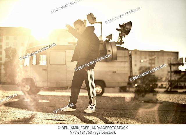 man in front of camper van, Blogger Adem Bayalan, in Munich, Germany