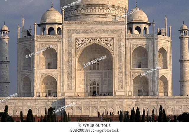 Close cropped view of exterior facade of the Taj Mahal